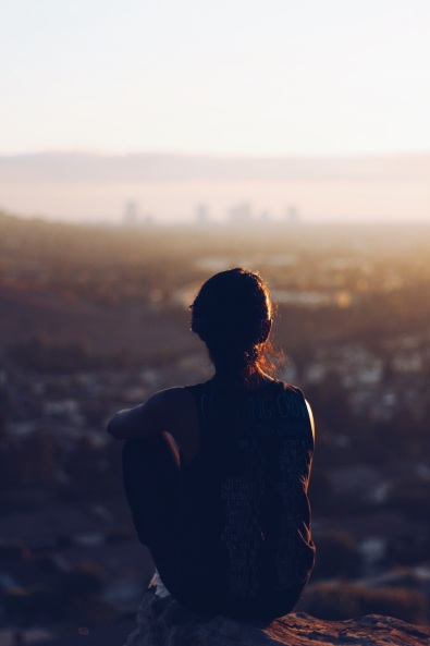 Woman above the city